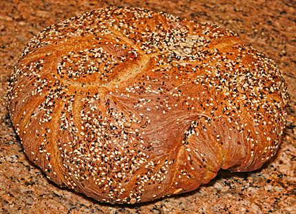 A finished loaf of multigrain bread.