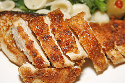 Close-up photo of chicken with brocolli rabe and orechetti.