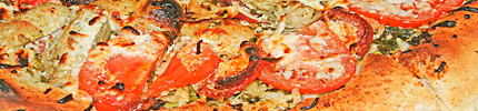 Close-up photo of a margherita pizza.