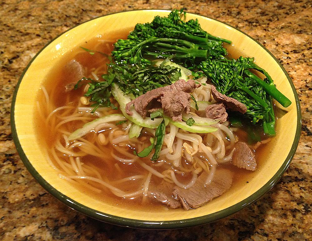 Bowl of pho bo Vietnamese beef noodle soup.
